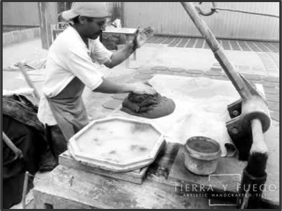 The making of Saltillo tile: clay is checked for thickeness evenness